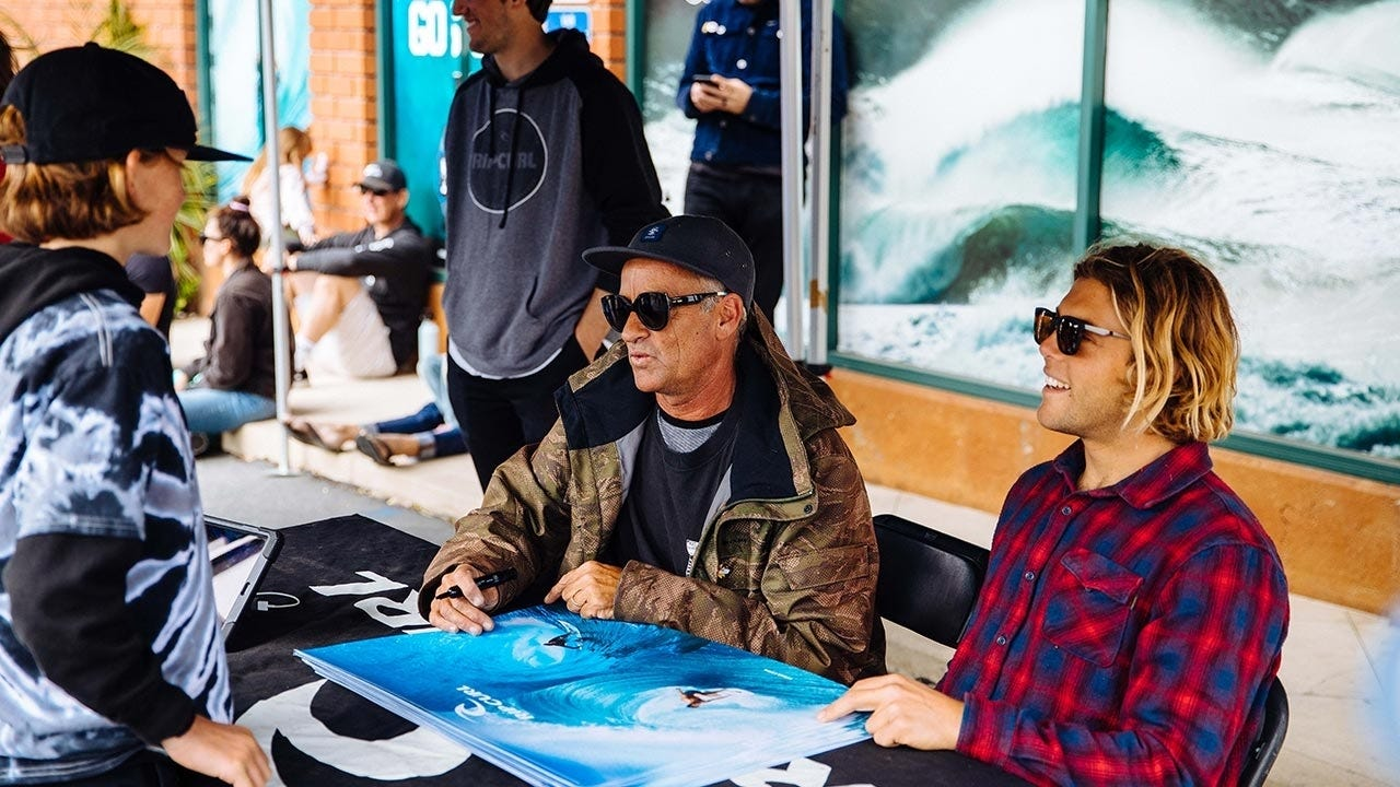 Tom and Conner Signing Posters