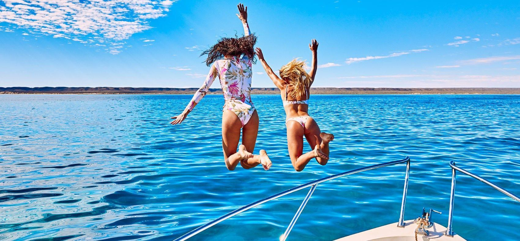 Jumping of a boat into the warm waters of Fiji