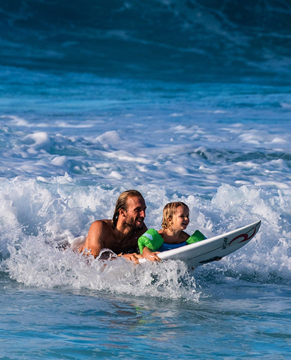 owen surfing with his kid